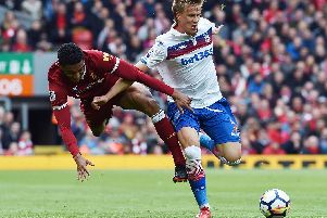 Mauritz Bauer holds off Liverpool defender Joe Gomez during an English Premier League clash