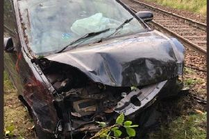 Pictures have emerged of a car that lay abandoned on the railway tracks at Brunstane Station. PIC: David
