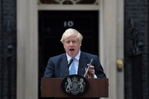 Boris Johnson makes a statement outside 10 Downing Street on Monday evening, as he pleaded with Tory rebels not to back a cross-party motion which could rule out no-deal Brexit. Picture: PA