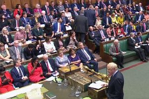 Tory MP Phillip Lee, pictured centre, walked across the House of Commons floor during a statement by the Prime Minister, Boris Johnson. PA