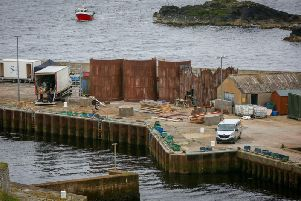 Production teams for the Netflix TV series The Crown construct various out buildings on Lybster Harbour in Caithness. The set will replicate Port Leith in South Georgia. Picture: SWNS