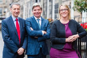 From left: Johnston Financial's Adrian Johnston, John McArdle and Suzanne Gray. Picture: Ian Georgeson