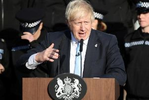 Prime Minister Boris Johnson speaking in front of police cadets in Wakefield