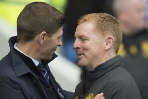 Steven Gerrard and Neil Lennon share a smile at Ibrox but it was the Celtic manager who had the last laugh. Picture: Ian Rutherford/PA