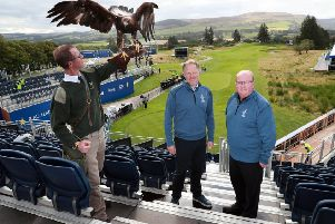 Solheim Cup Tournament Director Ross Hallett and Visit Scotland's Paul Bush with Albus, a 3 year old male golden eagle, and falconer Duncan Eade in the stands on the 1st tee at Gleneagles. Picture: Stewart Attwood