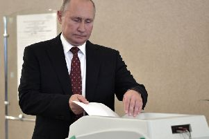 Russian President Vladimir Putin casts his ballot at a polling station during a city council election in Moscow. (Alexei Nikolsky, Sputnik, Kremlin Pool Photo via AP)