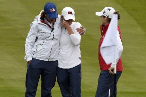 US captain Juli Inkster consoles a tearful Stacy Lewis, one of her wildcards, after the former Women's British Open appeared to hurt herself playing a shot in a practice round at Gleneagles.  Inkster was first on the scene in her buggy before other US players arrived to also give Lewis a hug. Picture: Ian Rutherford/PA Wire