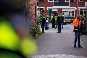 Police officers investigate a house after a shooting in which three people died ion Dordrecht, Netherlands. (Niels Wenstedt / ANO / AFP)