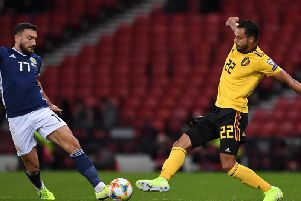 Scotland's Robert Snodgrass challenges Belgium's Nacer Chadli at a half-empty Hampden Park. Picture: Andy Buchanan / AFP