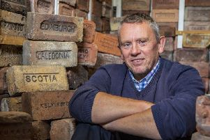 Mark Cranston, 56, has collected over 3,500 bricks since 2010. Picture: Katielee Arrowsmith / SWNS