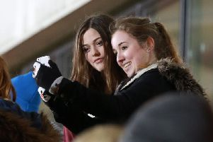 One Direction Louis Tomlinson's sister Felicite Tomlinson (left) with fans at Doncaster Rovers Keepmoat Stadium in 2014.