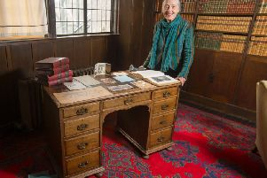 Ruth Currie, the granddaughter of Walter Blackie, with the desk which is now back in the library at The Hill House, which was designed by Charles Rennie Mackintosh for the publisher. PIC: NTS