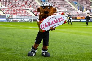 Dunfermline mascot Sammy the Tammy embraces the Tunnock's Caramel Wafer Challenge Cup. Picture: Ross Parker/SNS