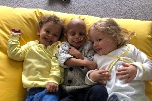 Caleb, who was diagnosed with a rare brain cancer, with sisters Poppy and Alyssia. Picture: SWNS
