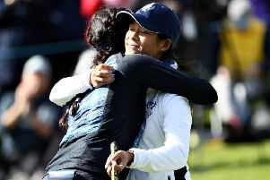 Rookie Celine Boutier, right, is hugged by Georgia Hall after their win in the opening session in the Solheim Cup at Gleneagles. Picture: Getty Images