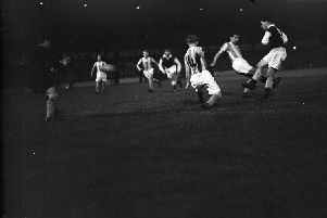 Jimmy Mulkerrin of Hibs has a shot blocked by Vorderbaumen and Wewers in the second leg at Easter Road