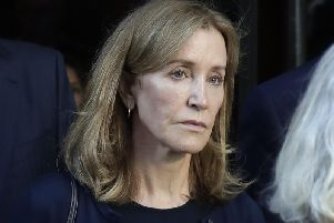 Actress Felicity Huffman leaves federal court after her sentencing in a nationwide college admissions bribery scandal. Photo: AP/Elise Amendola
