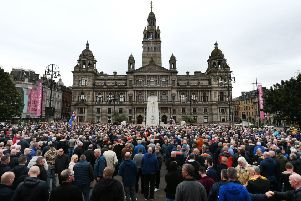 Loyalists gather yesterday in George Square to protest against Glasgow City Council's decision to ban marches this weekend. Picture: John Devlin