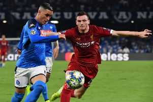 Andy Robertson tangles with Napoli forward Jose Callejon during the Champions League clash in Naples. Picture: AFP/Getty Images