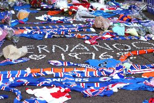Floral tributes outside the stadium for former Rangers player Fernando Ricksen. Picture: Andrew Milligan/PA Wire