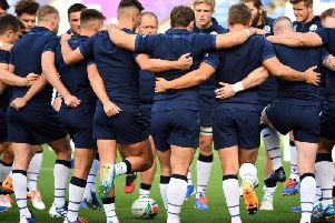 The Scotland players huddle during a training session ahead of their World Cup opener against Ireland
