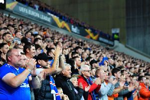 A general view of Rangers fans at Ibrox participating in a minute of applause for Gers legend Fernando Ricksen