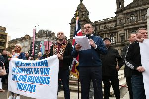 Demonstrators against the temporary march ban gather in Glasgow's George Square. The protest passed off peacefully. Picture: John Devlin