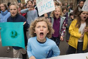 Schoolchildren marching through Cambridge city centre during a climate change protest. Picture: PA