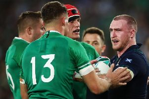 A frustrated Stuart Hogg exchanges words with Ireland centre Garry Ringrose during the 27-3 loss in Yokohama. Picture: Getty Images