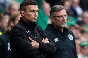 Hibs Manager Paul Heckingbottom, left, and Hearts boss Craig Levein during the derby. Picture: Ross Parker/SNS