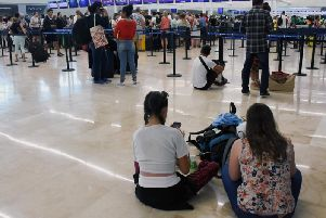 Passengers wait for news in Cancun airport.