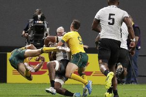 Australia's Reece Hodge, left, bounces back after his tackle on Fiji's Peceli Yato. Picture: Aaron Favila/AP