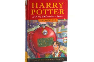 This rare edition of the first Harry Potter book has fetched more than 27,000 pounds at auction