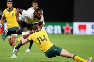 Pecali Yato of Fiji is tackled by Australia's Reece Hodge. Picture: Getty.