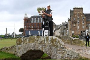 Frenchman Victor Perez lifts the Alfred Dunhill Links Championship trophy on the Swilken Bridge in St Andrews. Picture: Ross Kinnaird/Getty Images