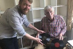 William Dean-Myatt (right) hands over the remaining shellac discs to the Library's Sound Collections Curator, Alistair Bell. Picture: The National Library of Scotland