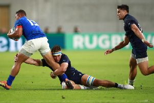Scotland star man Jamie Ritchie puts in a tackle on Samoa centre Alapati Leiua in Kobe on Monday. Picture: Getty Images