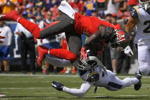 Tampa Bay Buccaneers' wide receiver Chris Godwin, top, is tackled by LA Rams' Eric Weddle. Picture: AP.