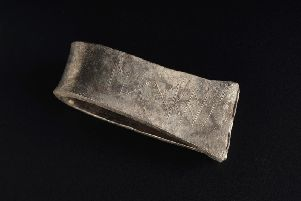 The silver arm ring that carries the runic inscription for  'Egbert'. PIC: NMS.