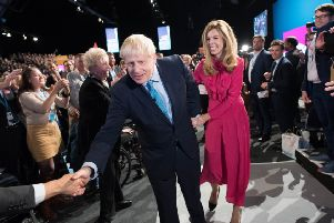 Boris Johnson, with girlfriend Carrie Symonds, is applauded after his speech to the Tory party conference (Picture: Stefan Rousseau/WPA Pool/Getty Images)