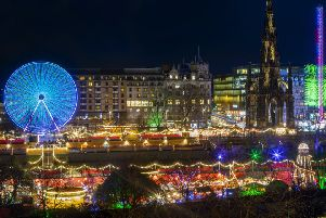 A long exposure photograph captures Scott Monument along side the 60 metre high Sky Flyer fairground ride which lights up Edinburgh's Christmas skyline in Princes Street Gardens. (Picture: SWNS)
