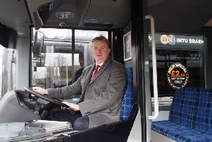 McGill's board director Sandy Easdale at the wheel of one the operator's new fleet. Picture: Contributed