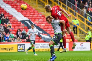 Sam Cosgrove heads an equaliser for Aberdeen.