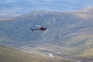 A helicopter delivers material for footpath repairs in Torridon. PIC: NTS.