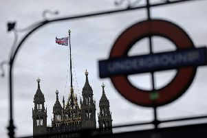 A Union flag flies from a pole atop the Victoria Tower at the Houses of Parliament in London. Picture: AFP/Getty