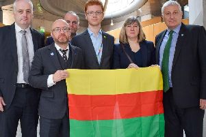 Scottish Green MSPs with flag of Rojava, the autonomous region of north and east Syria.