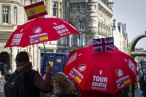 Guides offer city tours to tourists on the Royal Mile in Edinburgh. Picture: Andy Buchanan/AFP