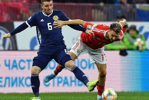 John Fleck battles for possession during Scotland's match with Russia.