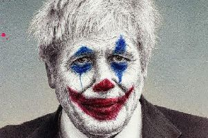James Mylne of his the detail of his new artwork depicting Prime Minister Boris Johnson as comic book character The Joker. Picture: PA