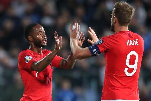 Raheem Sterling and Harry Kane celebrate in a match marred by racist abuse from Bulgarian fans (Picture: Nick Potts/PA Wire)